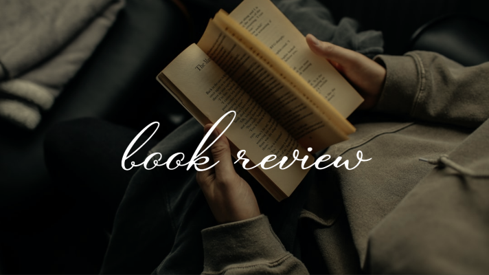 girl holding book, text says 'book review'
